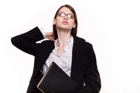 womanlike: Attractive businesswoman  student holding her hair in Studio