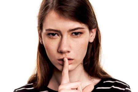 noiseless: Shhhhh Woman! Finger On Lips. Silent - Silence Stock Image