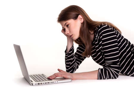 Young Thinking Woman with PC on Floor Ecommerce Stock Image photo