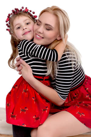 happy little girl: Mother And Daughter in studio isolated on white background - Stock Image