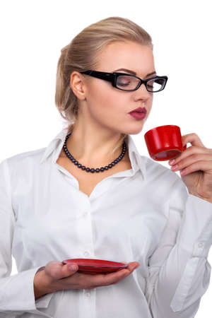 Young beautiful blonde businesswoman drinking coffee and having a break - Stock Image