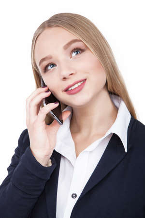 20 29: Attractive Brunette Woman Talking on Her Cell Phone Isolated white - Stock Image