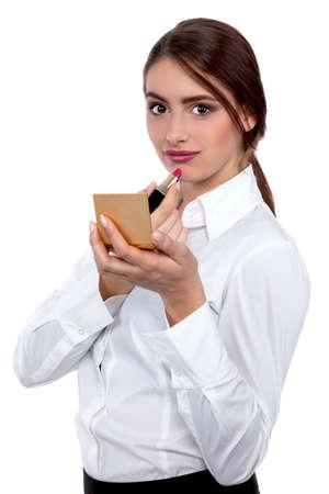 Young Beautiful Business Woman putting make-up - Stock Image