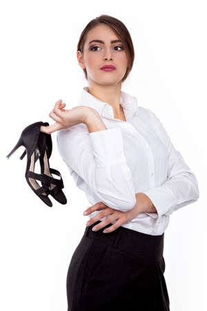 office shoes: High Heel shoes off at office - Successful Young businesswoman - Stock Image Stock Photo