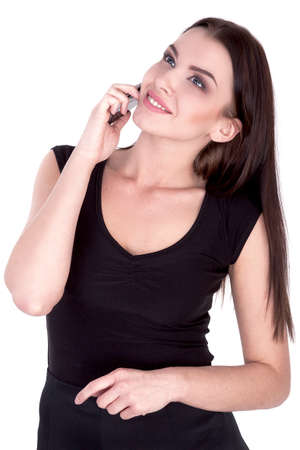 20 29 years: Attractive Brunette Woman Talking on Her Cell Phone Isolated white - Stock Image