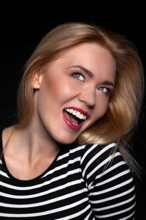 Portrait of a Beautiful Blonde Woman Model black background studio - Stock Image