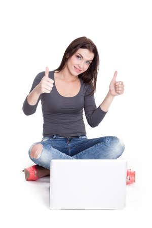 legs crossed at knee: Good News travel fast - woman shopping online satisfied - Stock Image Stock Photo