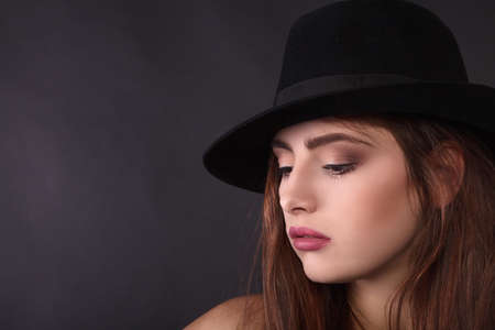 Beautiful woman in retro style with black mafia hat - Stock Image