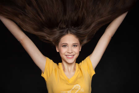 Cool and Glamorous Young Woman with Beautiful Flying Hair - Stock Image Stock Photo