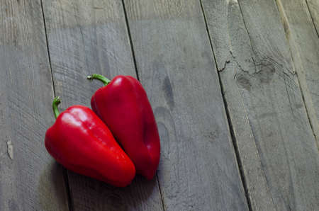 paprica: red Pepper on wooden background red paprica