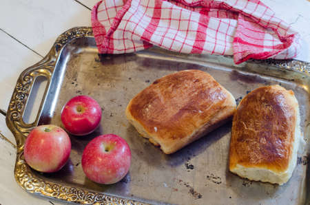 traditionally russian: Fresh baked pasties with apples, napkin, background Stock Photo