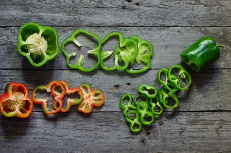 pepper: Photo of sliced colorul peppers over wooden table Stock Photo