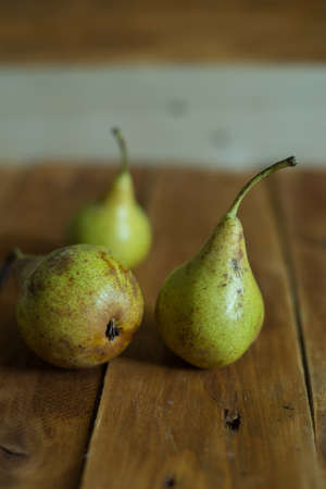 Pears on wooden background. Green pears. Natural light. Vintage board. Ripe fruits