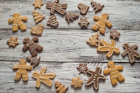 Christmas cookie and candy on wood, food top view. Gifts with craft paer. Text.