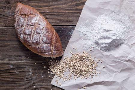 Healthy bread on wooden background. Natural light. Standard-Bild