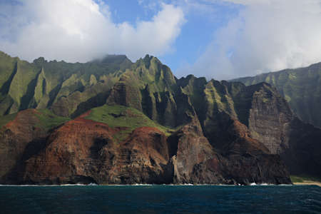 the rugged NaPali coast of the island of Kauai seen from the ocean