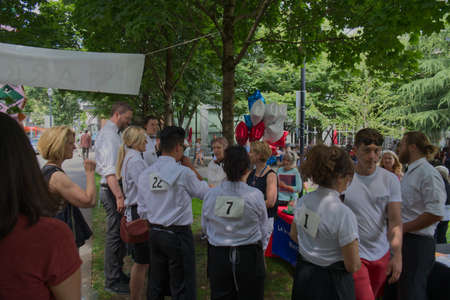 PORTLAND, OREGON/USA - JULY 13, 2019 : Competitors receive their final briefing before the start of the Waiters' Race at the annual Bastille Day celebration sponsored by the Alliance Francaise de Portland