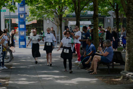 PORTLAND, OREGON/USA - JULY 13, 2019 : The final lap of the Waiters' Race at the annual Bastille Day celebration sponsored by the Alliance Francaise de Portland