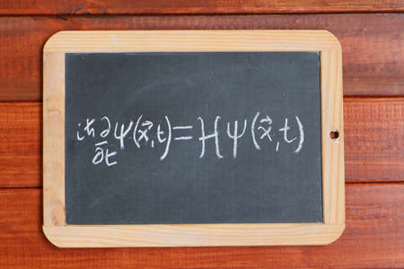 Schrodinger wave equation written on a blackboard Imagens