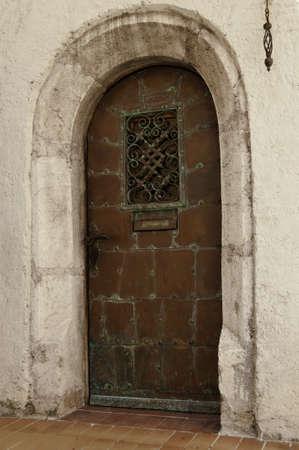 Old oxidated copper entrance door with verdigris photo