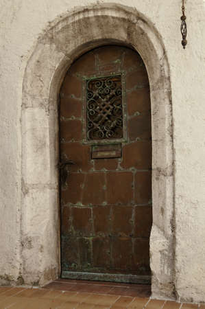 oxidated: Old oxidated copper entrance door with verdigris