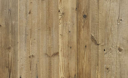 A brown, rustic wood texture with natural structure. Stock Photo