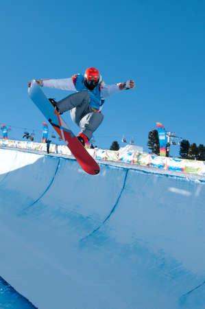 yog: KUEHTAI, AUSTRIA - JANUARY 14, 2012 - YOG 2012, Youth Olympic Games Innsbruck 2012, SNOWBOARD Halfpipe, Men. Rider: Victor Habermacher from France Editorial