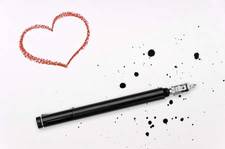 Red crayon heart, ink pen and spatter on white paper Stock Photo - 12285470