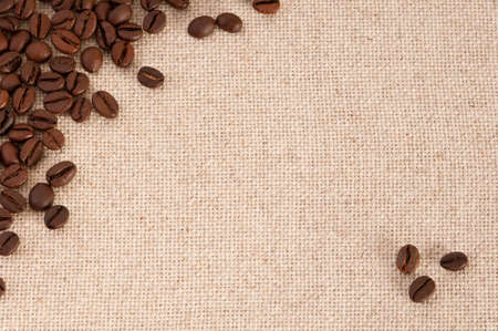 coffee sack: A background with coffee beans on canvas