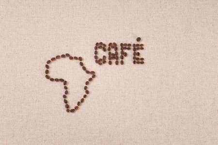 Coffee beans on canvas in the shpe of the map of Africa and the word Cafe