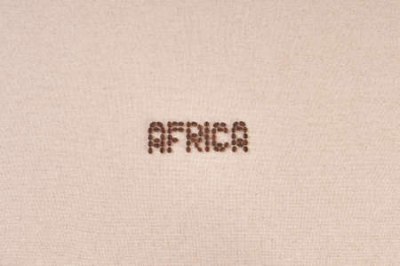 Canvas background with coffee beans forming the word Africa photo