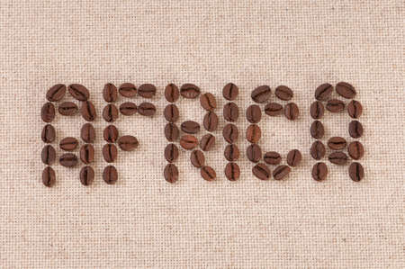 Closeup shot of coffee beans forming the word Africa photo