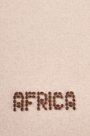 The word Africa written with selected coffee beans on canvas background photo