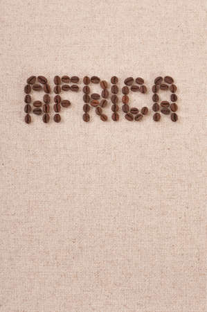 The word Africa formed with selected coffee beans on canvas background photo