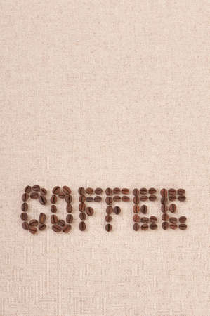 Coffee beans on burlap background photo