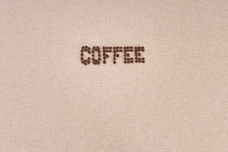 Coffee menu background  roasted coffee beans on canvas photo