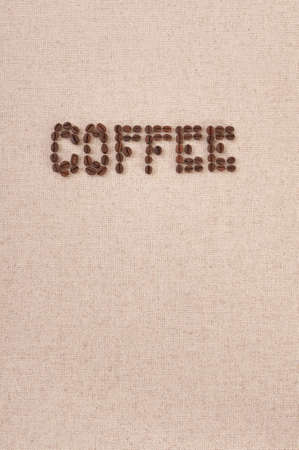 Background with roasted coffee beans on canvas photo