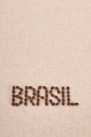 Brasil written with coffee beans on canvas background photo