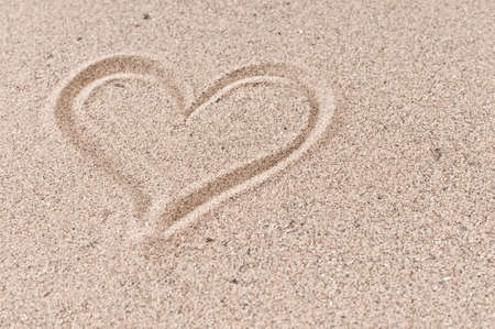 Holiday love concept  heart in the beach sand Stock Photo