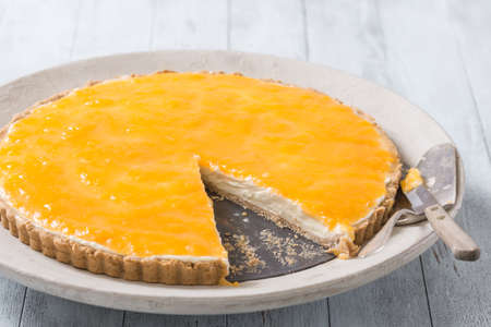 passion fruit: Delicious homemade cheese cake with orange passion fruit topping Stock Photo