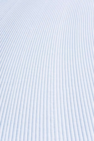 groomer: Fresh snow groomer tracks on a ski piste