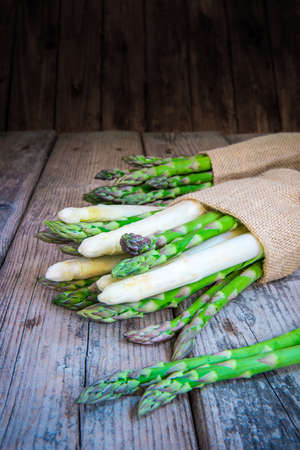 Bundle of fresh and healthy asparagus on wooden table