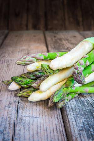 Bundle of fresh organic asparagus on wooden table