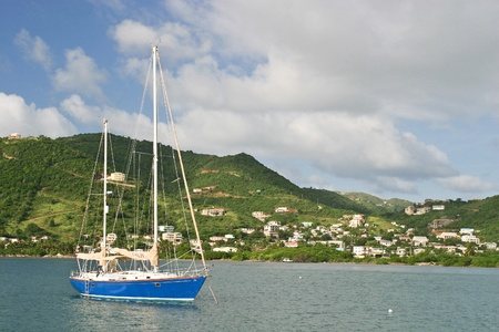 A sailboat is anchored in the harbor of Belle Vue on the British Virgin Island of Jost Van Dyke. Redakční