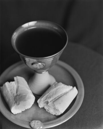 Communion setting with chalice, plate, wine and bread.