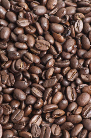 Closeup of roasted coffee beans ready for grinding
