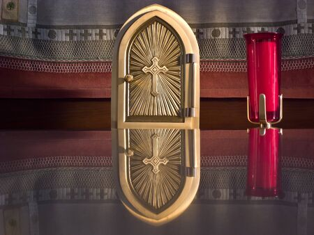 Golden tabernacle on the altar of a country church  Stock Photo - 13097015