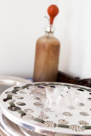 Glass communion cups and a bulb actuated filler are reminders of an earlier era of church services  Stock Photo