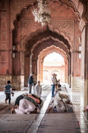 Muslim men pray at the Jama Masjid  Pearl Mosque  in Old Delhi, India  Editorial