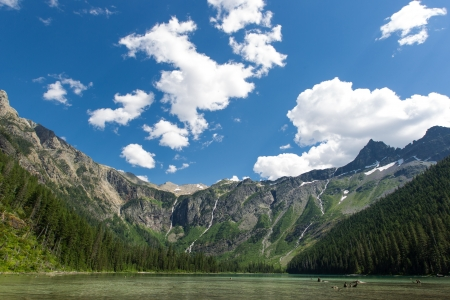A view toward Bearhat Mountain in the center and the Little Matterhorn on the left from Avalanche Lake in Glacier National Park, Montana